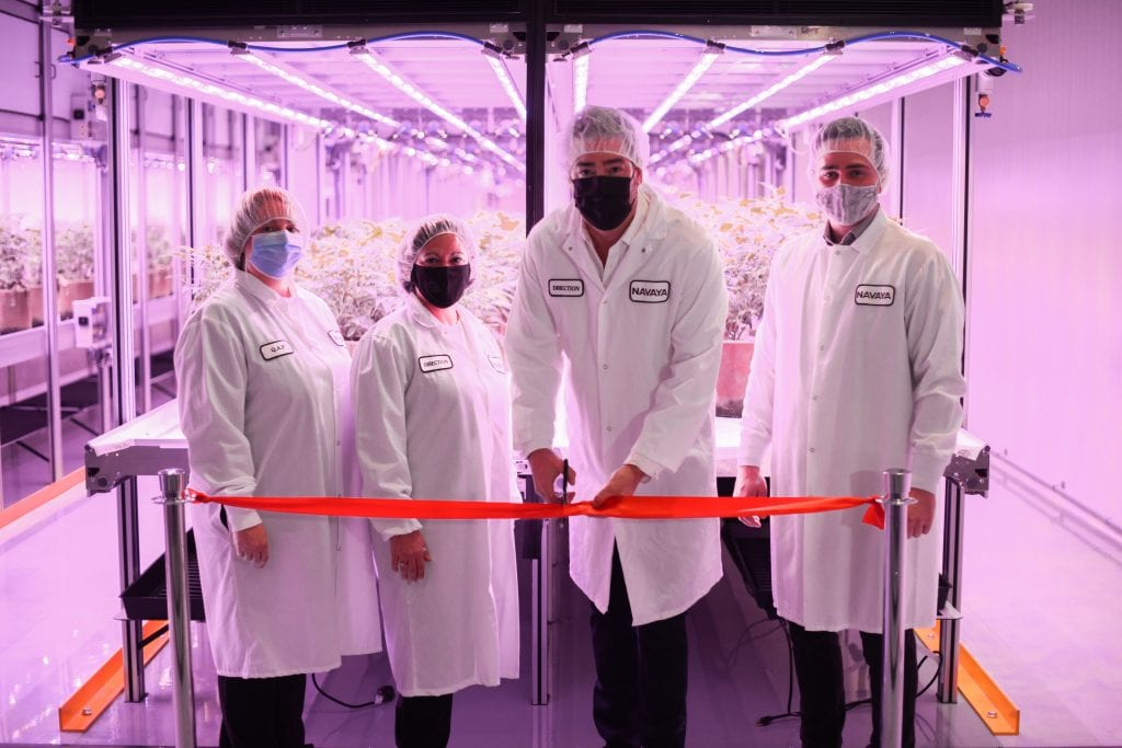 Mark Stermer, CEO, and the Navaya team cut the ribbon introducing the company's unique growing machine